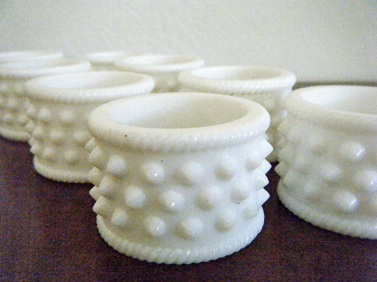 Set of 8, Vintage Milk Glass Hobnail Napkin Rings, Original Boxes, Midcentury Modern, A Rare Find and All Absolutely Perfect. $250.00, via Etsy.