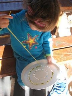 Fine motor sewing. Rainbow plastic plates. Drill holes in mandala patterns.