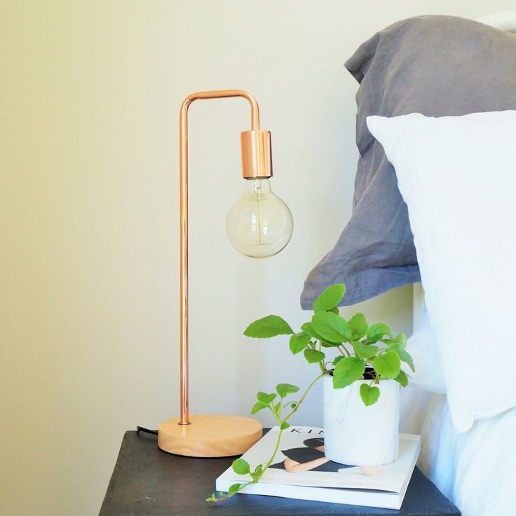 Modern Copper Table Lamp with Wooden Base. This lamp looks great beside the Bed or as a reading light on a desk. Edison Bulb included Size: 49.5cm x 15cm  Dia
