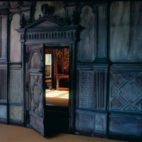Haddon Hall, hidden door • in a hall filled with molding and panels this would not standout as a door.  Good job