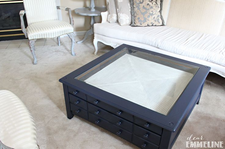 Nautical inspired coffee table. Imagine how fun this would be to play in the sand and place little boats and sea creatures then change them around :-)