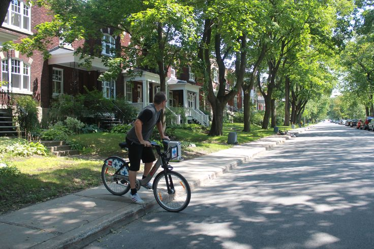 Bixi biking down the streets of Outremont.