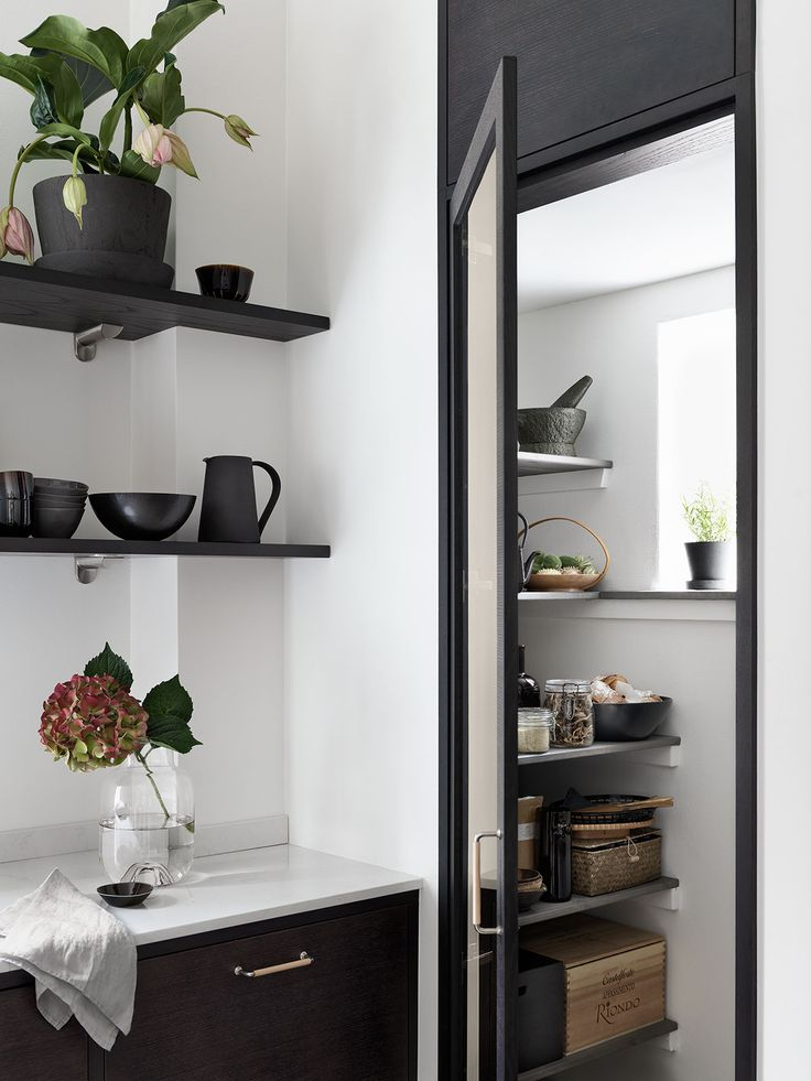 Love all the black kitchen cabinets in shelving in this Kitchen of the Week: A Swedish Kitchen with a Place for Everything: Remodelista Est Living @estemag #estliving #estdesigndirectory