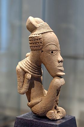 African art - Nok - NOK refers to the area the piece was created or found.  Similar eye features (shape and hollowed pupils) many partial sculptures found.
