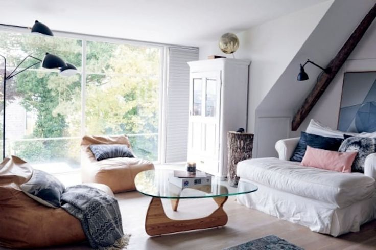 Two Copenhagen designers have furnished their home with pieces from IKEA, the Danish design house Gubi, and their rural childhood homes, as seen in Femina. Note the stump used as a side table!