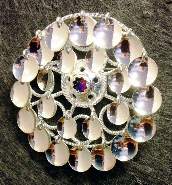Inspired by Sami brooch, 'risku', contemporary Swedish silver brooch. Designer: Torild Labba | En silverbrosch inspirerad av en traditionell samisk brosch, risku, av Torild Labba. (Foto Shop in Lapland)