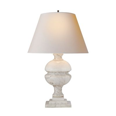 The transitional lamp base is topped with a simple natural paper shade and is dimmable, adding seamless function to the elegant form. Perfectly sized for a bedside table or your living room, this lamp will both draw the eye and illuminate your late-night reading. It's the perfect addition to your home's designer decor.