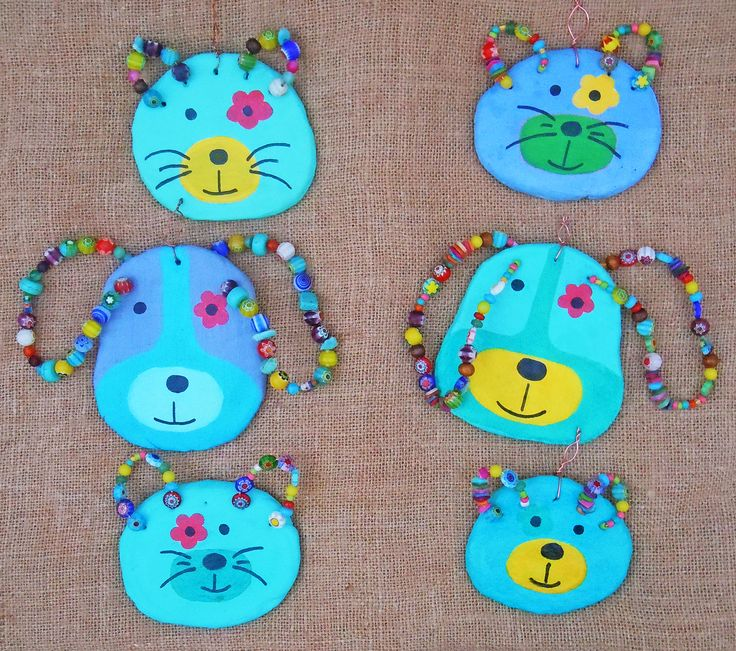 Ceramic and beads dogs and cats to hang on the wall..;)