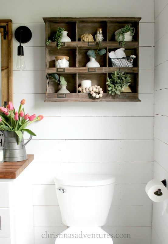 Love this idea for decorating above your toilet - this whole farmhouse bathroom renovation is filled with wonderful ideas!