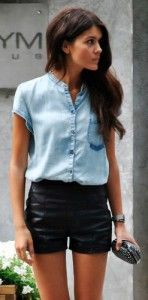 Denim shirt with short sleeves & leather shorts and black clutch. Learn how to wear denim this fall 2015 >>> http://justbestylish.com/how-to-wear-denim-this-fall-2015/