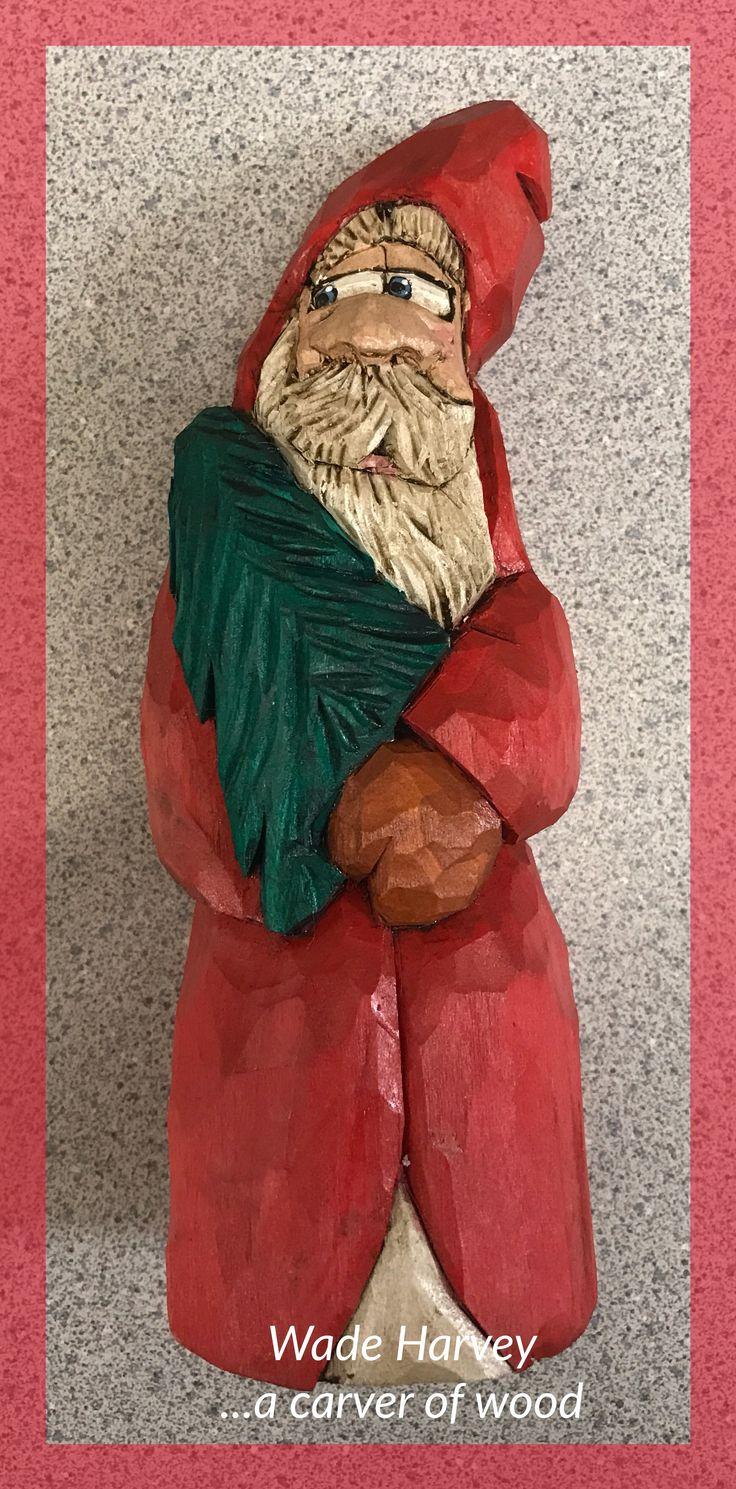 Santa holding a tree