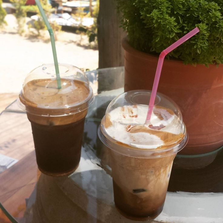 Mine is definitely the one with the pink straw. 😆💖👱💟 #frape #coffee #cappuccino #freddo #latte #summer #summermood #beach #beachlife #relax #seaside #instacoffee #instacoffeebreak #instalike #coffeeart #straw #pink #green #couple