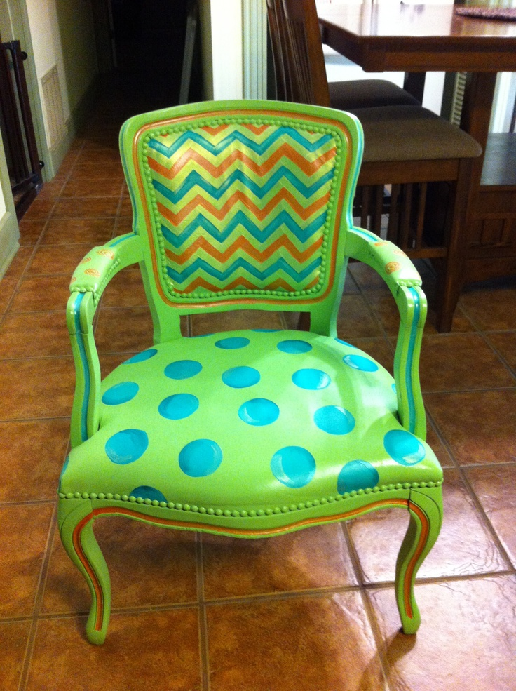 Discarded old chair that I spray painted with plastic bonding Rustoleum and then painted with acrylic paint with textile medium.  Sealed with acrylic sealer spray.