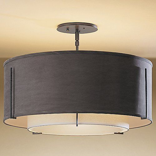 The Hubbardton Forge Exos Double Shade Semi-Flushmount Medium is simply perfect for all your contemporary lighting requirements as its graceful appeal and avant-garde pattern puts your interiors apart from others. The Exos Double Shade Semi-Flushmount Medium features hand-forged wrought-iron, fabric shade and translucent finishes.