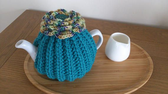 Teal  hand knitted tea cosy with crochet flower top and