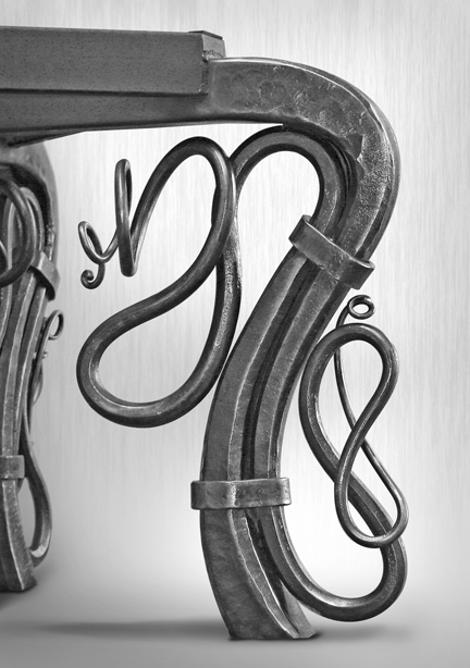 Dining Table Or Conference Table - Detail - Forged iron legs with a thick granite top. This table is heavy! The iron base alone weighing about 500 lbs