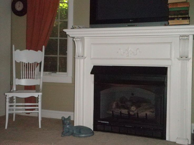 old painted fireplace mantel pictures | The antique mantel fronts a gas fireplace.