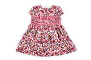 Vestido en corduroy para bebe niña, en tela estampada con florecitas rosadas, fuchsia y azul.