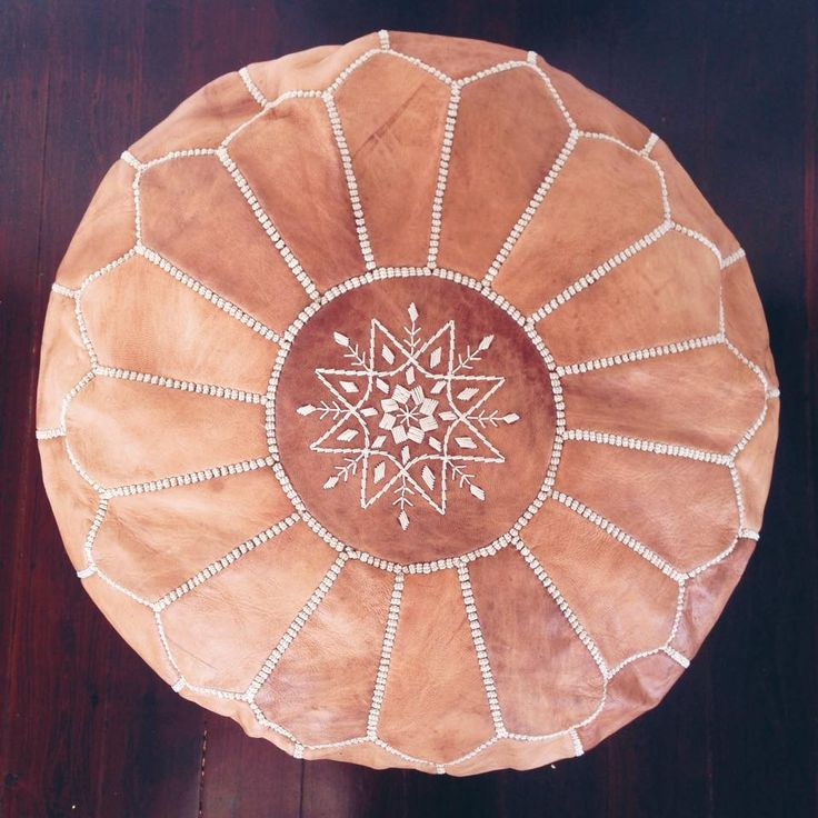 moroccan leather pouf-- Tori likes the snowflake design. It's a good place to sit while playing with her on the floor.