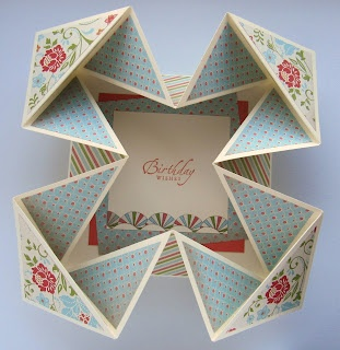 Card folds open to box