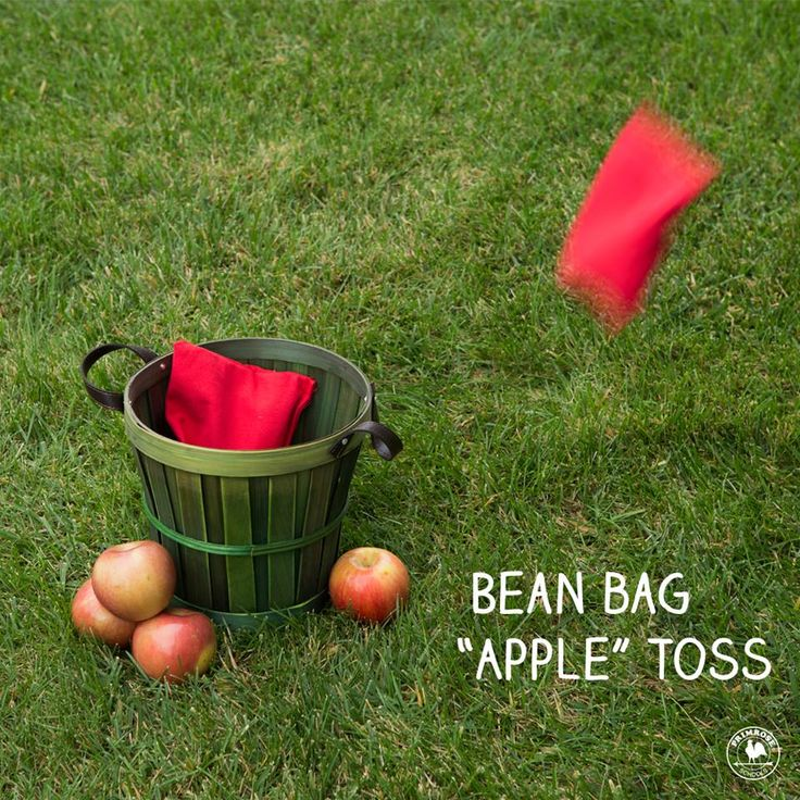"""Playing this fun, fall-inspired """"apple"""" toss game with bean bags helps your child develop gross motor skills."""
