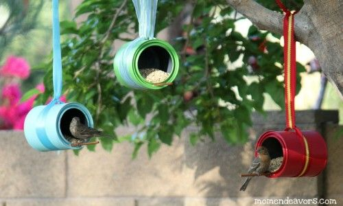 colourful bird feeders using old tins