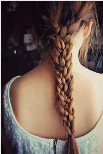Why have two braids running along the side when you can combine them as one giant basket braid in the back? Cheat by leaving a length of hair down the center, then just braid the two side braids together