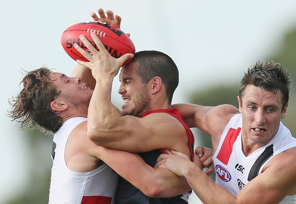 James Magner of the Demons is tackled by Jack Steven and Stephen Milne of the Saints during the round three NAB Cup AFL match between the Melbourne Demons and the St Kilda Saints at Casey Fields on March 9, 2013 in Melbourne, Australia. (March 8, 2013 - Source: Scott Barbour/Getty Images AsiaPac)