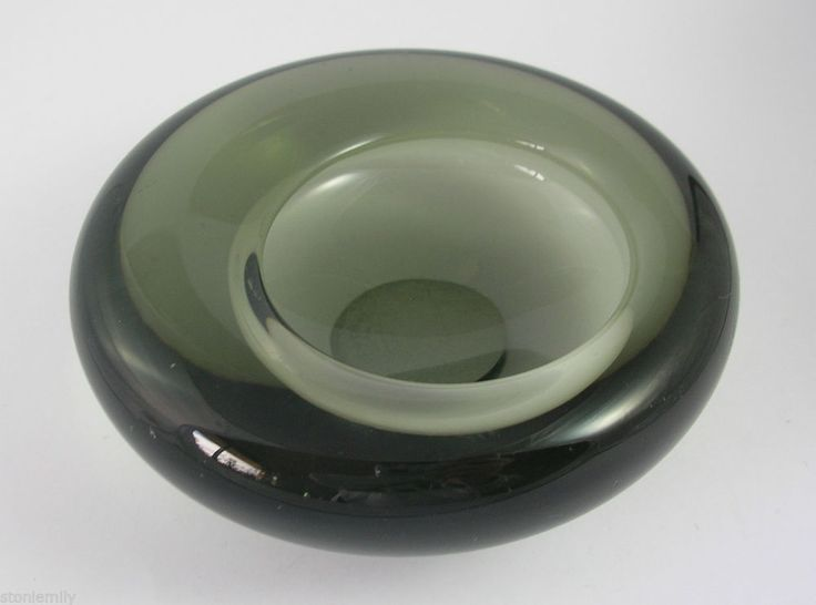 From our ebay site 'Ems Eclectic Emporium' -Holmegaard Mid Century Danish Art Glass Ashtray. Named 'Eccentric' this piece forms part of the 'Smoke' range by Per Lutken but was also produced as part of the 'Akva' range in an ice blue glass. We love these as quirky tealight holders and they can also be used as small bowls.
