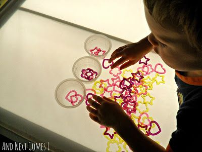 Sorting shapes on the light table from And Next Comes L