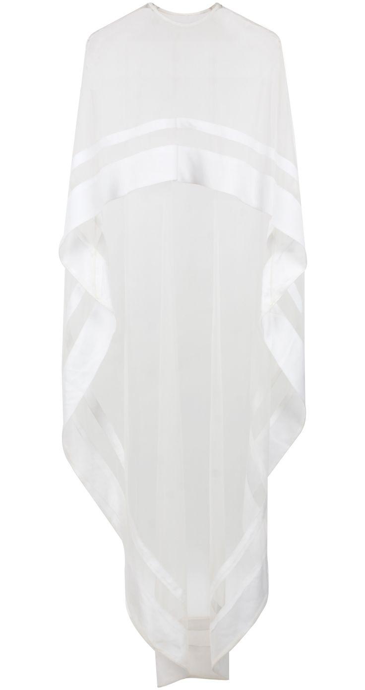 White asymmetrical net cape by NIKHIL THAMPI. Shop at http://www.perniaspopupshop.com/whats-new/nikhil-thampi-white-asymmetrical-net-cape-nktc081317.html