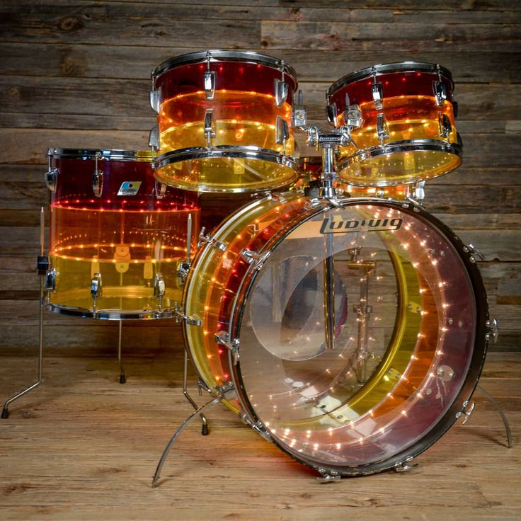Ludwig Tivoli Vistalite set, with complete working lighting system, in excellent condition, no cracks or spiderwebs.  Sizes are 12x8, 13x9, 16x16, 24x14, and rare matching 5x14 snare drum.  All parts are original and in working order, with the exception of 6 lights on the inside of the snare drum...