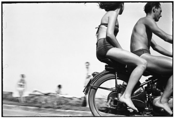 """Gabor Szilasi, """"The Eloquence of the Everyday.""""  Pictured: Motorcyclists at Lake Balaton, 1954."""