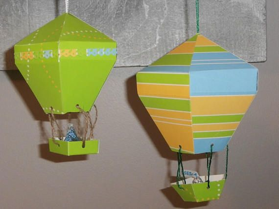 These adorable and whimsical hot air balloons will be the talk of your party. Use them as decorations / hanging decor, centerpieces (doll rods are added for support), party favors, gifts or all of the above.  Handmade and made to order in your color(s) and occasion in mind. Weddings  Receptions  Bridal Showers  Baby Showers  Birthday Parties  Going Away Parties  Any Holiday Party  Mothers /Fathers Day  July 4th  Easter/Christmas Or any other occasion you can dream up!  The regu...