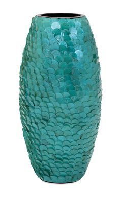 Catch a mermaid's tail, shimmering iridescent blue, lacquered capiz shells decorate a ceramic vase straight from under the sea.