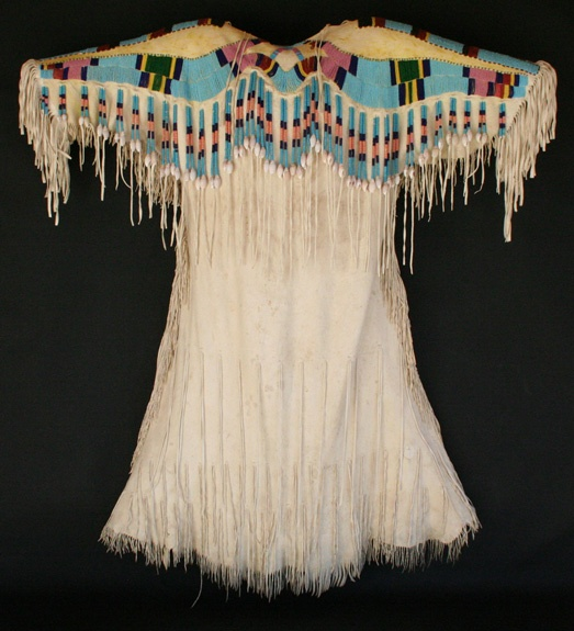 Cayuse Umatilla Dress1920Partially beaded on shoulders and arms, beaded fringe. Morning Star Gallery Santa Fe
