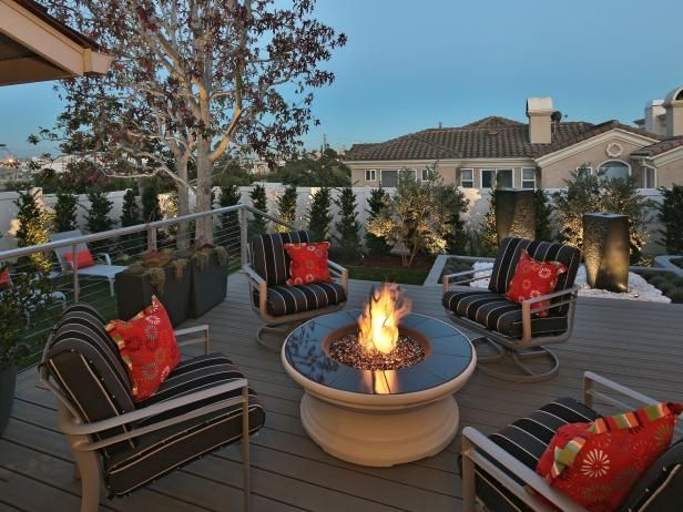 Get warm & cozy by a fire pit with these clever fire pit design ideas from…
