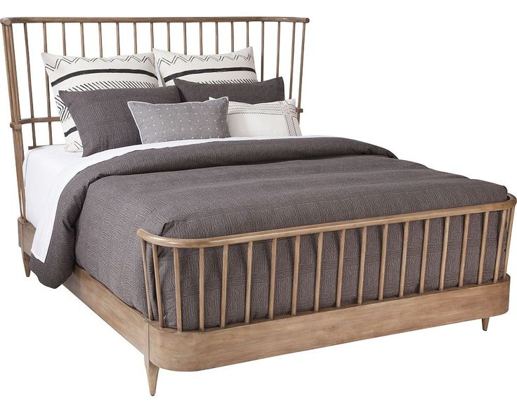 Tired of sleigh beds? Try Ellen's Cordell Spindle Bed. Inspired by classic Windsor chair design elements, the canted spindle features are found on the headboard and shallow rail/footboard frame. The Cordell Spindle Bed comes in a rustic modern oak finish.
