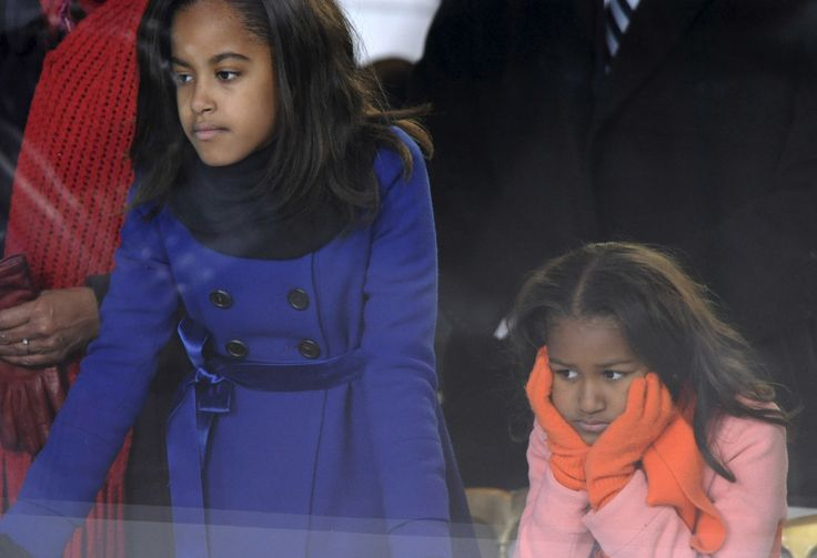 U..S President Barack Obama's daughters Malia and Sasha Obama watch the inaugural parade from their father's reviewing stand in Washington January 20, 2009. Barack Obama became the first black U.S. president on Tuesday and declared it is time to set aside petty differences and embark on a new era of responsibility to repair the country and its image abroad. (REUTERS/Jonathan Ernst/UNITED STATES)  via @AOL_Lifestyle Read more…