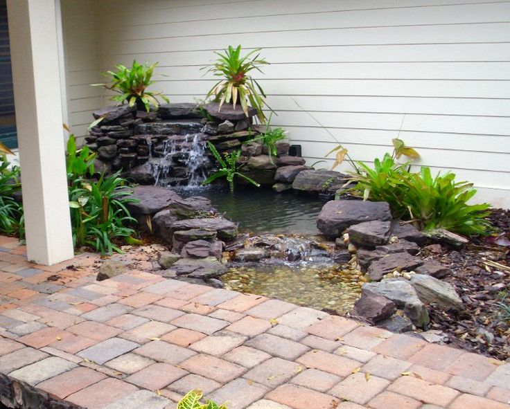 backyard ponds | Backyard Getaway renovated pond
