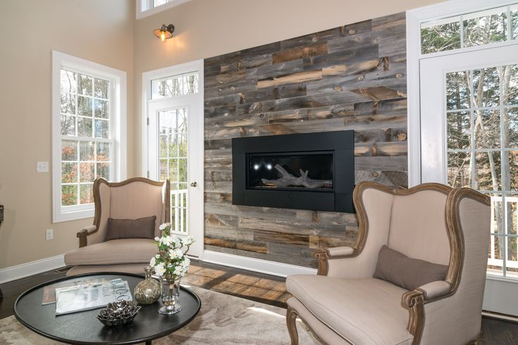 The perfect blend of traditional & rustic design. @stikwooddesign reclaimed fireplace wall!