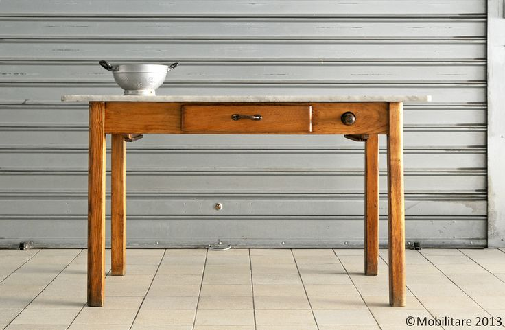 Mobilitare - A traditional chestnut kitchen table with white marble top, drawer and rolling pin.