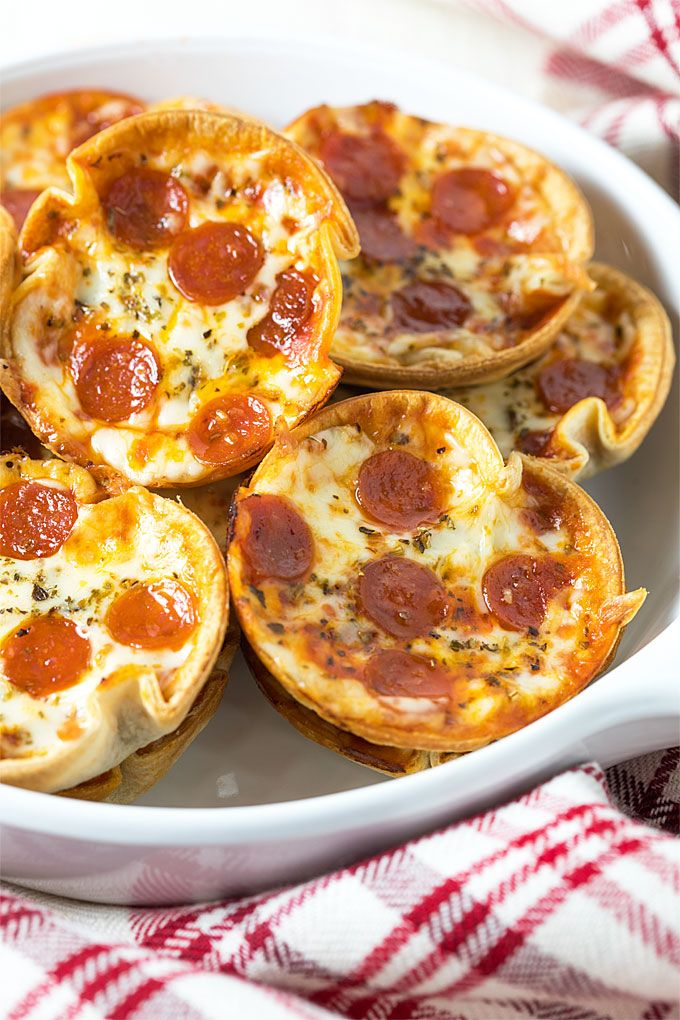 These 5-ingredient mini cupcake pizzas are an easy appetizer or dinner ready in just 20 minutes!