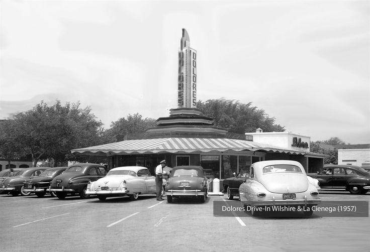 This photo of the Dolores Drive-in near the northwest corner of Wilshire Blvd and La Cienega Blvd shows us LA's drive-in restaurant culture as it was reaching its zenith. I would have loved the chance to wolf down a cheeseburger, slurp a chocolate thick shake, and shove a handful of Suzie Q fries while sitting in one of those roomy gas guzzlers we can see here!