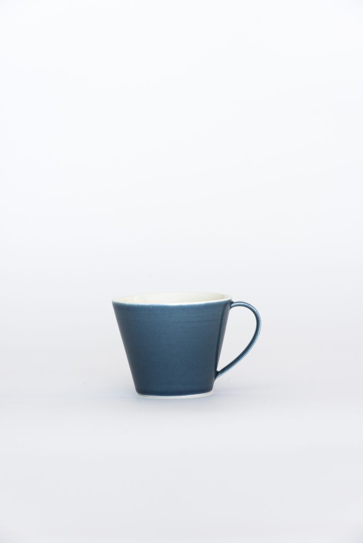https://councilofobjects.com.au/shop/mug-navy Susan Frost Navy Mug. Styling: Elise Short of Council of Objects. Photography: Sven Kovac. Location: The Props Dept.