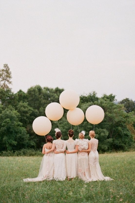 bridesmaids with balloons by elizabeth messina