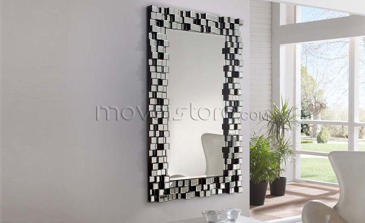 Espelho com moldura formada por pequenos espelhos quadrados com bisel dispostos a diferentes níveis. Suporte realizado em madeira com acabamento preto. Preparado para pendurar em posição horizontal ou vertical. Para mais informações, por favor, contacte-nos.