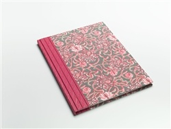 With a pink floral motif and an embroidered spine, this journal with 100% tree-free paper is just right for the summer.