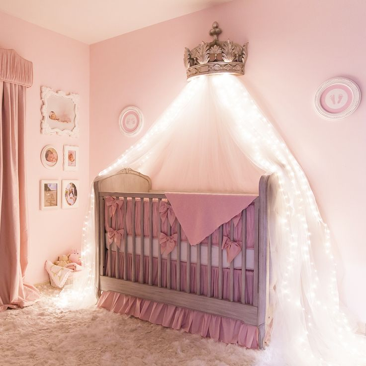 A classic and elegant ballerina princess nursery featuring a canopy bed crown with starry string lights.