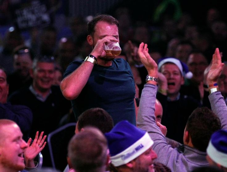 Danny Willett: Masters champion necks a pint at the World Dart Championships as Lee Westwood reveals annoyance